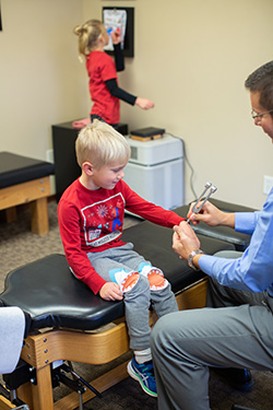 Chiropractor Watertown SD Bryan Dingsor with Little Patient